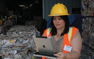 Rainbow IT director Gisela Gamboa checks the status of the recycling plant on her iPad.
