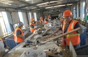 Workers sort through construction and demolition materials on the Krause line at Rainbow.